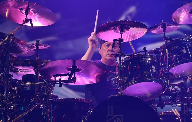 "Jeff Miers writes that Neil Peart was ""widely considered one of the most ambitious and technically gifted drummers and lyricists in rock history."" Photo here is from Rush's 2015 concert at what was then called First Niagara Center. (Sharon Cantillon/Buffalo News)"