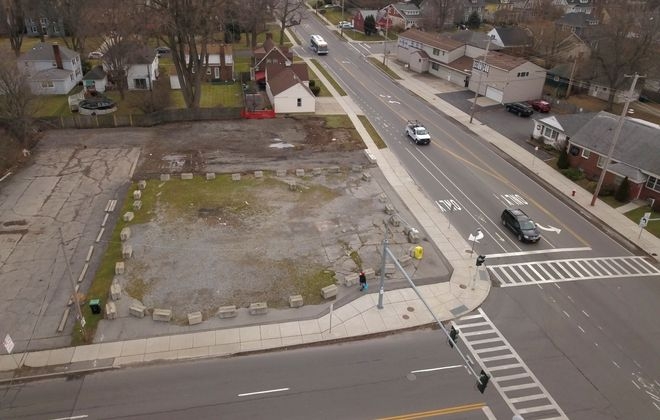 Aerial photo looking east at former gas station at corner of Niagara Falls Boulevard and Kenmore Avenue. Station was demolished and site has sat vacant for years. Amherst wants to turn this property and L-shaped parcel that wraps around it into a gateway park for the town. (John Hickey/Buffalo News)