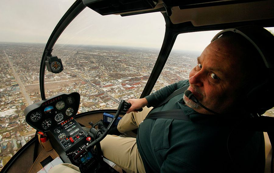 Mark Croce pilots a helicopter over Western New York in 2009.  This is not the helicopter he was in Thursday night.  (Derek Gee/Buffalo News)