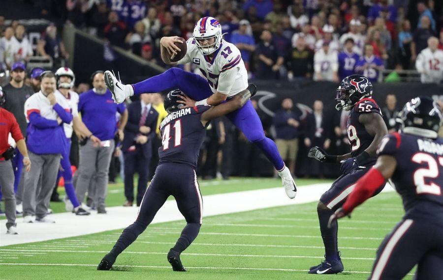 Bills quarterback Josh Allen rushes for a first down over Texans inside linebacker Zach Cunningham in the fourth quarter at NRG Stadium. (James P. McCoy/Buffalo News)