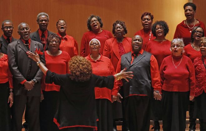 Bessie Patterson leads her City-Wide Choir on the stage of Kleinhans Music Hall during the 2019 Dr. Martin Luther King Jr. celebration. (Robert Kirkham/The Buffalo News)