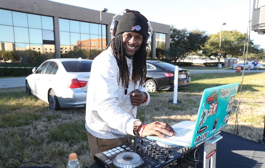 Hoyet Andrews, also known as DJ SoulStar, providing music for the Bills faithful at Saturday's pregame tailgate in Houston. (James P. McCoy/Buffalo News)