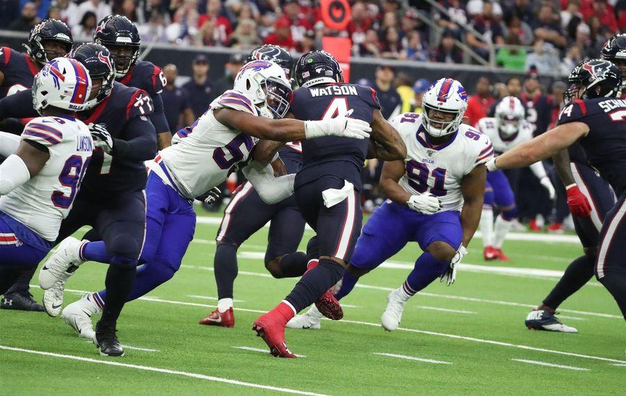 Bills defensive end Jerry Hughes (55) sacks Texans quarterback Deshaun Watson (4) in the second quarter at NRG Stadium in Houston on Saturday, Jan. 4, 2020. (James P. McCoy/Buffalo News)