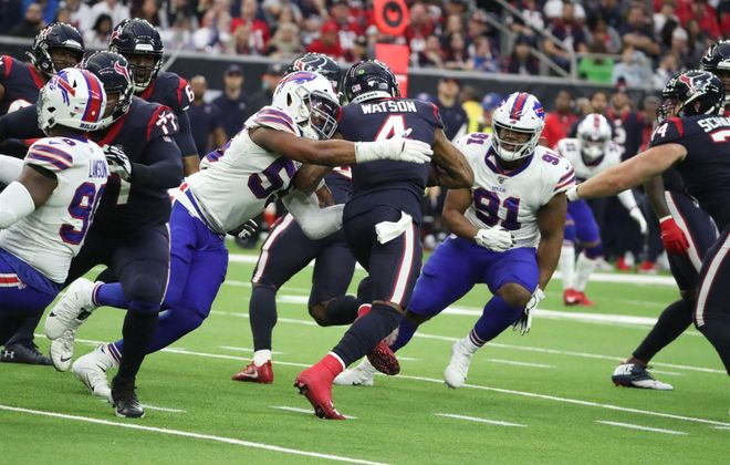 Bills defensive end Jerry Hughes sacks Texans quarterback Deshaun Watson in the second quarter at NRG Stadium in Houston on Saturday, Jan. 4, 2020. (James P. McCoy/Buffalo News)