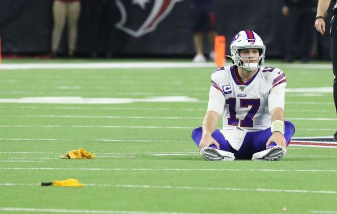 Bills quarterback Josh Allen sits on the ground after being called for grounding at NRG Stadium in Houston. (James P. McCoy/Buffalo News)