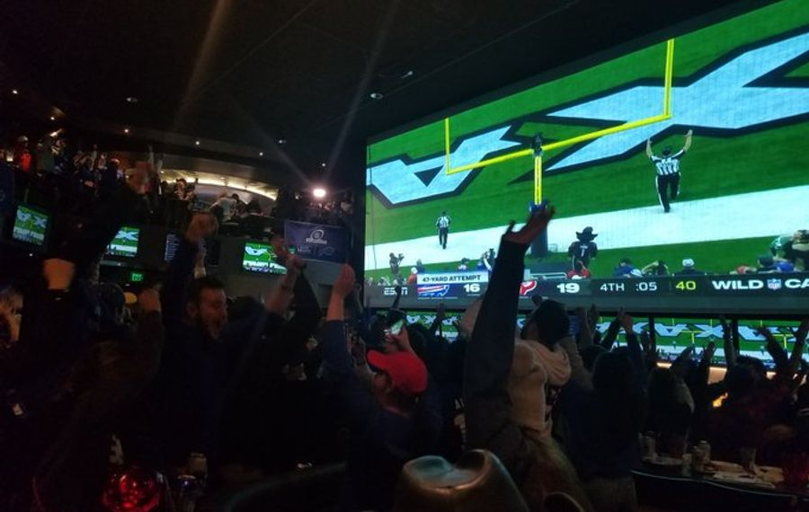 Fans at (716) Food & Sport celebrate as a field goal with 5 seconds left forces overtime in the Bills-Texans playoff game on Jan. 4, 2020. (Thomas J. Prohaska/Buffalo News)
