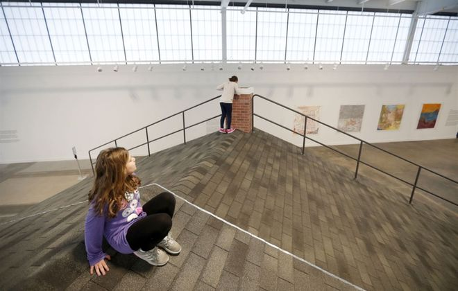 Carly Skibinski, left, and her sister Olivia walk on a piece by artist Heather Hart at the Albright-Knox Northland. (Mark Mulville/Buffalo News)