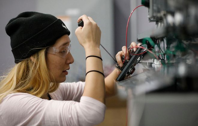 Amanda Myke installs a variable frequency drive during a lab in the Electrical Construction and Maintenance Electrician program program offered at the Northland Workforce Training Center. (Derek Gee/News file photo)