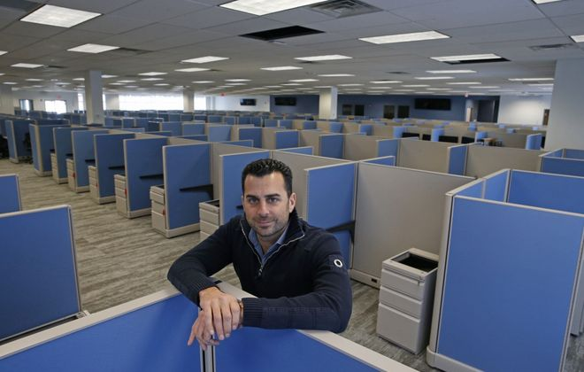 Ryan Sasson, CEO of Strategic Financial Solutions, inside the company's expanded office space. (Robert Kirkham/Buffalo News)