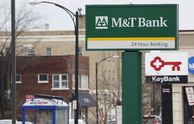 M&T Bank and KeyBank signs in the plaza at Delaware and Hertel in Buffalo, Wednesday, Dec. 30, 2015.  (Derek Gee/Buffalo News)