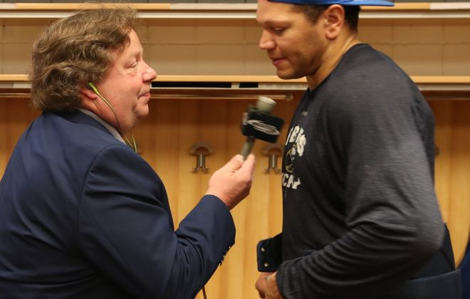 Paul Hamilton, of WGR 550 interviews Buffalo Sabres right wing Kyle Okposo in 2017. (James P. McCoy/Buffalo News)