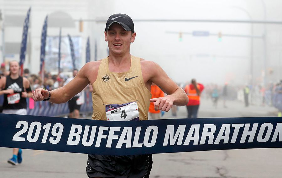 Men's winner Joe Whelan crosses the finishline during the Buffalo Marathon Sunday, May 26, 2019. (Mark Mulville/Buffalo News)