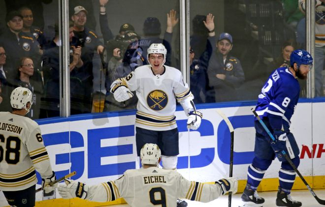Buffalo's Jimmy Vesey celebrates his goal with Jack Eichel and Victor Olofsson against Toronto in November. (Robert Kirkham/News file photo)