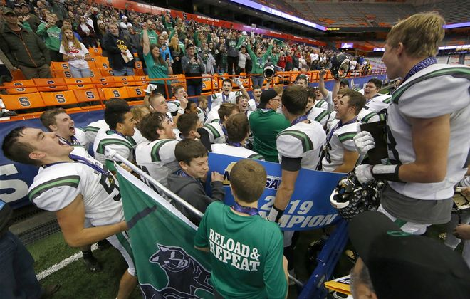 Clymer-Sherman-Panama players and coaches after the team defeated Moriah for the NYSPHSAA Class D State Final High School football game at the Carrier Dome on Nov. 29.(Harry Scull Jr./News file photo)