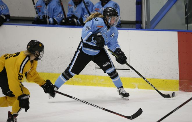Buffalo Beauts forward Taylor Accursi controls a bouncing puck against the Boston Pride during the first period at the Amherst Northtown Center. (Derek Gee/News file photo)