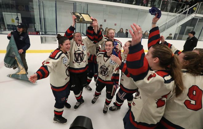 Williamsville players celebrate winning the Section VI title with a 3-2 overtime win over Kenmore/GI in the girls hockey at Cornerstone Arena in Lockport on Feb. 3. (James P. McCoy/Buffalo News)