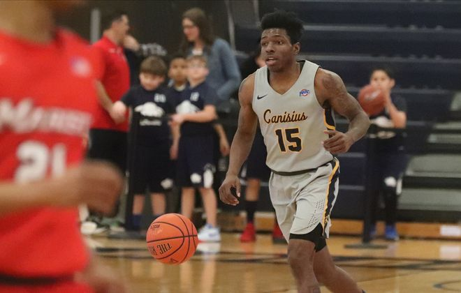 Canisius Golden Griffins guard Majesty Brandon (15) brings the ball up the court in the first half at Canisius College in Buffalo,N.Y. on Sunday, Feb. 2, 2020. (James P. McCoy/Buffalo News)