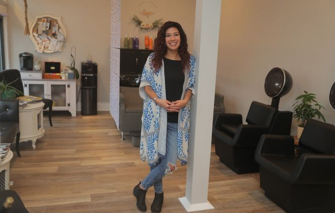 """Charlene Minx wears a kimono-inspired top and favorite jeans and accessories at an early morning photo shoot at Salon de Coquette. """"Kimonos are something I live in; you can put them with anything,"""" she said.  (John Hickey/Buffalo News)"""