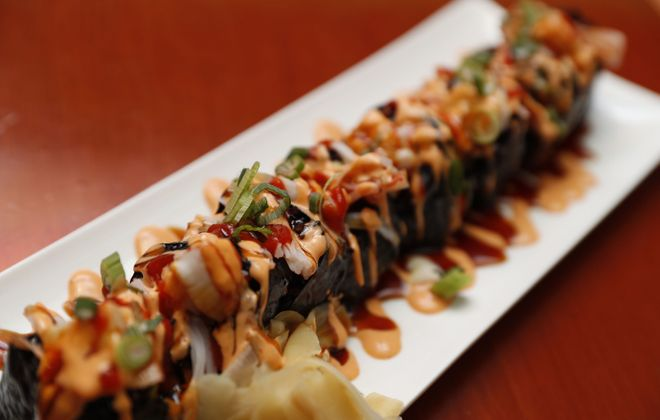 The volcano sushi roll, sculpted with black rice, from Street Asian Food.(Sharon Cantillon/Buffalo News)