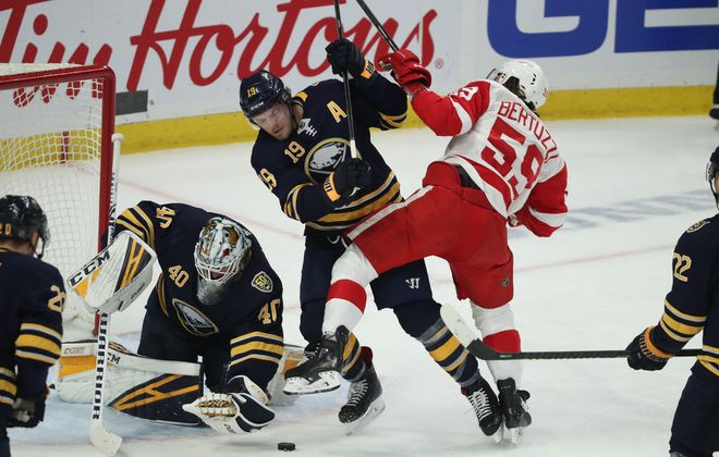Buffalo Sabres goaltender Carter Hutton (40) makes a save  in front of Buffalo Sabres defenseman Jake McCabe (19) and Detroit Red Wings left wing Tyler Bertuzzi (59) in the first period at Key Bank Center in Buffalo,N.Y. on Tuesday, Feb. 11, 2020. (James P. McCoy/Buffalo News)