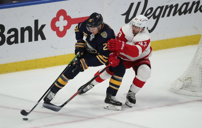 Buffalo Sabres defenseman Rasmus Dahlin (26) battles Detroit Red Wings left wing Darren Helm (43) for the puck in the first period at KeyBank Center on Tuesday, Feb. 11, 2020. (James P. McCoy/Buffalo News)