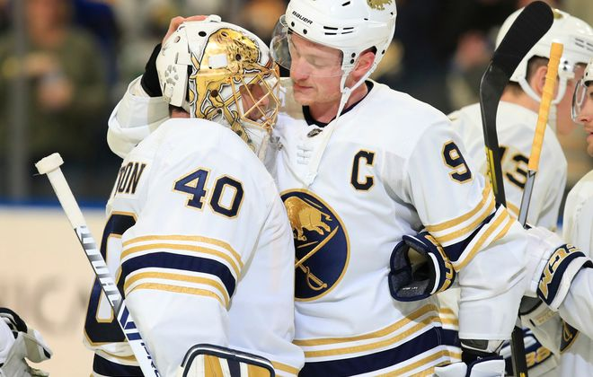 Buffalo Sabres captain Jack Eichel congratulates Carter Hutton on his overtime victory over the Columbus Blue Jackets at the KeyBank Center, on Thursday, Feb. 13, 2020. (Harry Scull Jr./Buffalo News)