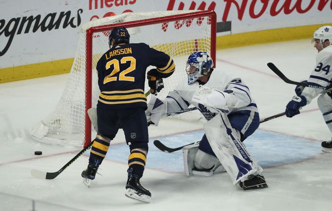 Buffalo Sabres center Johan Larsson (22) scores the first goal of the game against Toronto Maple Leafs goaltender Frederik Andersen (31) in the second period at KeyBank Center on Sunday, Feb. 16, 2020. (James P. McCoy/Buffalo News)