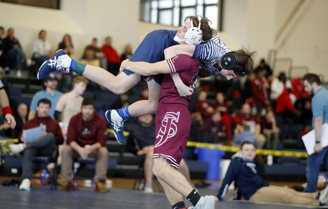 St Joe's junior Jackson Alagna takes down Canisius freshman Chase Harbold in their 132-pound preliminary match during the Monsignor Martin All-Catholic wrestling tournament at Canisius High School in Buffalo on Sunday, Feb. 9, 2020. (Mark Mulville/Buffalo News)