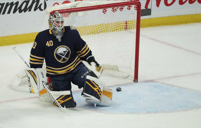 Colorado Avalanche left wing Andre Burakovsky (95) scores a goal against Buffalo Sabres goaltender Carter Hutton (40) in first period at Key Bank Center in Buffalo,N.Y. on Tuesday, Feb. 4, 2020. (James P. McCoy/Buffalo News)