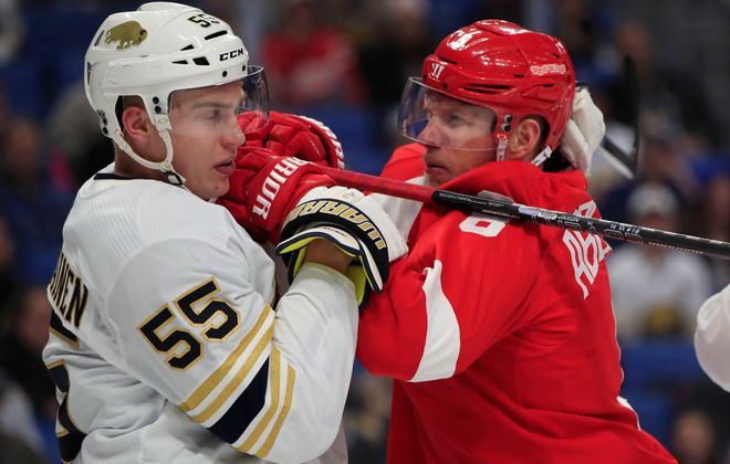 Buffalo Sabres defenseman Rasmus Ristolainen mixes it up with Detroit's Justin Abdelkader during the second period Thursday at KeyBank Center. (Harry Scull Jr./Buffalo News)