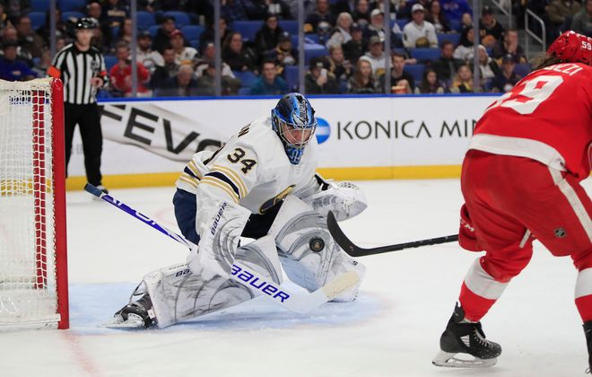 Buffalo Sabres goaltender Jonas Johansson makes a save on Detroit Red Wings Tyler Bertuzzi during the second period at the KeyBank Center , on Thursday, Feb. 6, 2020. (Harry Scull Jr./Buffalo News)