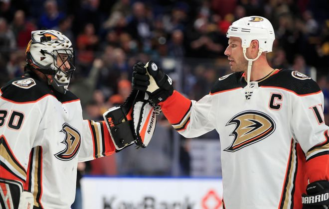 Anaheim Ducks goaltender Ryan Miller is congratulated on his victory by captain Ryan Getzlaf against the Buffalo Sabres at the KeyBank Center, on Sunday, Feb. 9, 2020. (Harry Scull Jr./Buffalo News)