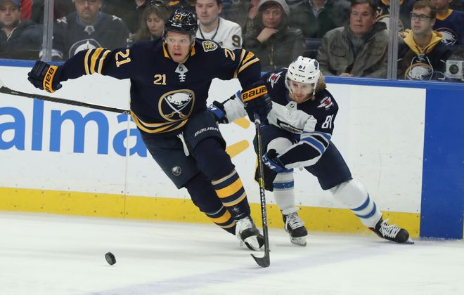 Buffalo Sabres right wing Kyle Okposo (21) battles Winnipeg Jets left wing Kyle Connor (81) for the puck in the first period at KeyBank Center on Sunday, Feb. 23, 2020. (James P. McCoy/Buffalo News)