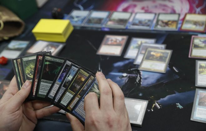 Magic: the Gathering is a popular card game played at spots like Dragon Snack Games on Maple Road in Amherst. (Sharon Cantillon/Buffalo News)