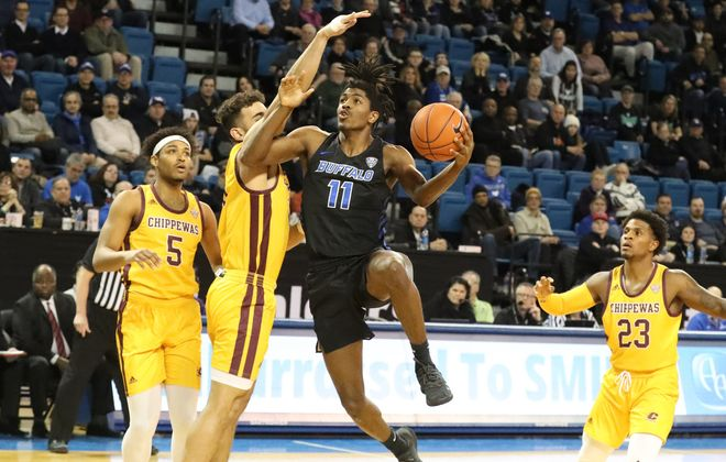 Buffalo Bulls forward Jeenathan Williams (11) scores two points over Central Michigan Chippewas guard Kevin McKay (20)n the first half at Alumni Arena in Amherst,N.Y. on Friday, Feb. 7, 2020. (James P. McCoy/Buffalo News)