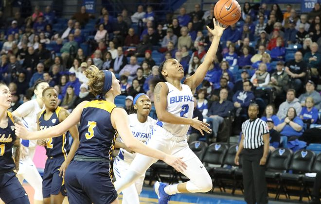 Buffalo Bulls guard Dyaisha Fair scores two points over Toledo guard Mariella Santucci in the first half at Alumni Arena Saturday. (James P. McCoy/Buffalo News)