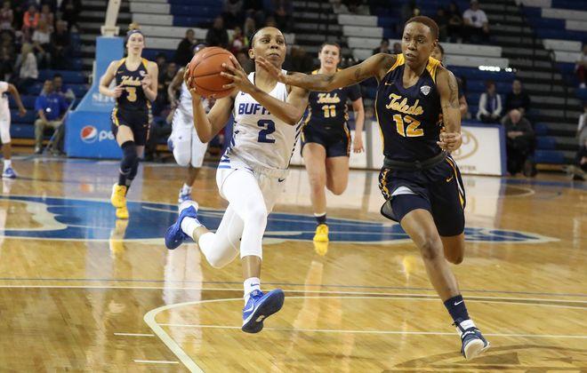 Buffalo Bulls guard Dyaisha Fair (2) scores two points over Toledo Rockets guard Tatyana Davis (12) in the first half at Alumni Arena on Saturday, Feb. 8, 2020. (James P. McCoy/Buffalo News)