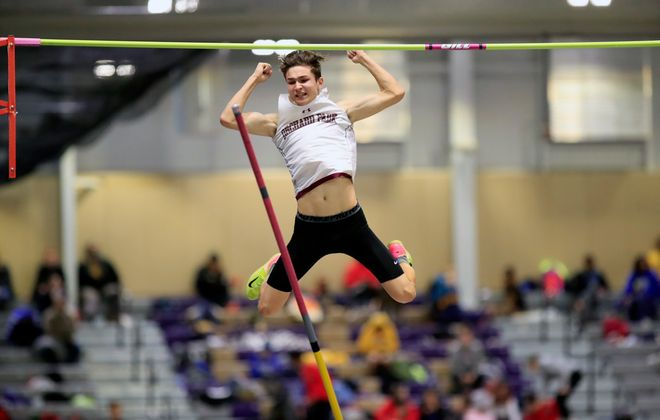 Kegan Mancabelli from Orchard Park High School clears 14 feet to break the school record and win the pole vault during the Section VI boys and girls indoor track team championships at the Kerr-Pegula Fieldhouse on Feb. 8, 2020. (Harry Scull Jr./Buffalo News)