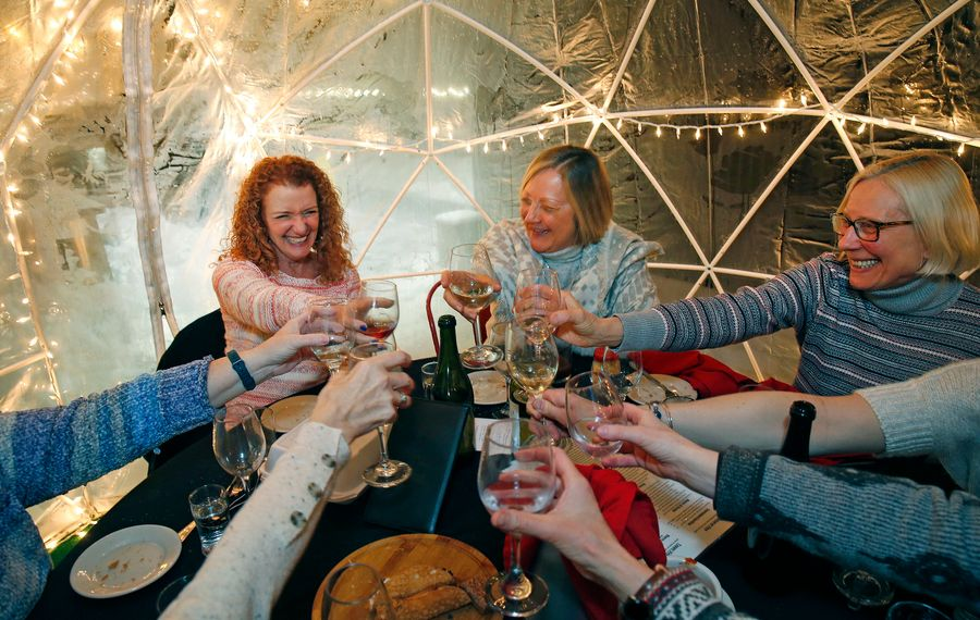 Judi Donner, top left, of Hamburg, enjoyed a late birthday celebration with her friends inside an igloo on the rooftop at Tappo. Also pictured are Helen Brady, center, of Buffalo, and Ellen Tomczak, of Derby. (Robert Kirkham/Buffalo News)