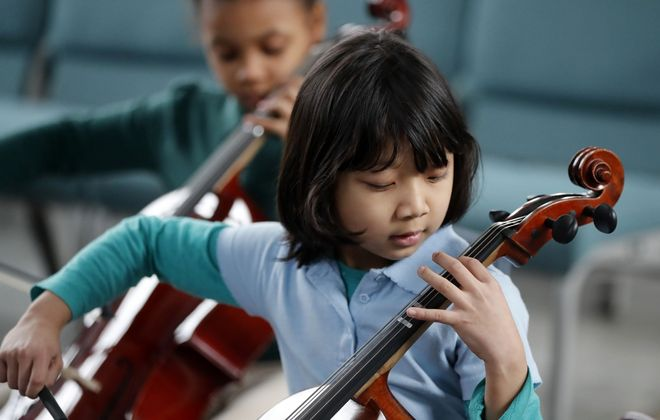 Buffalo String Works student Hoih Nu plays a scale during practice at the Buffalo Dream Center Wednesday, Feb. 12, 2020.  (Mark Mulville/Buffalo News)