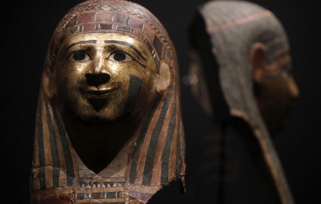 "This mummy mask is just a tease of what's ahead at the ""Golden Mummies of Egypt"" exhibition, which opens Saturday at the Museum of Science. (Mark Mulville/Buffalo News)"