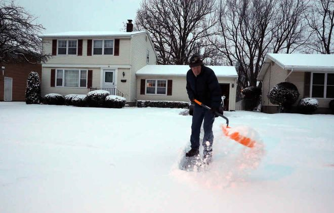 Leo Fedor shovels snow at his home on Kaymar Drive,  in Amherst, on Thursday, Feb. 6, 2020. (John Hickey/Buffalo News)