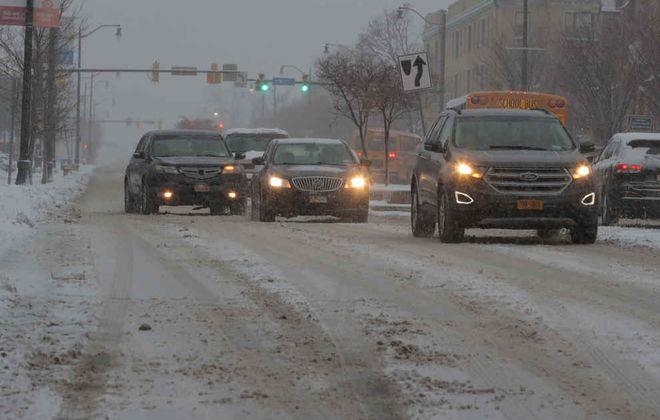 Snowy commute on Main Street on Friday, Feb. 7, 2020. (John Hickey/Buffalo News)