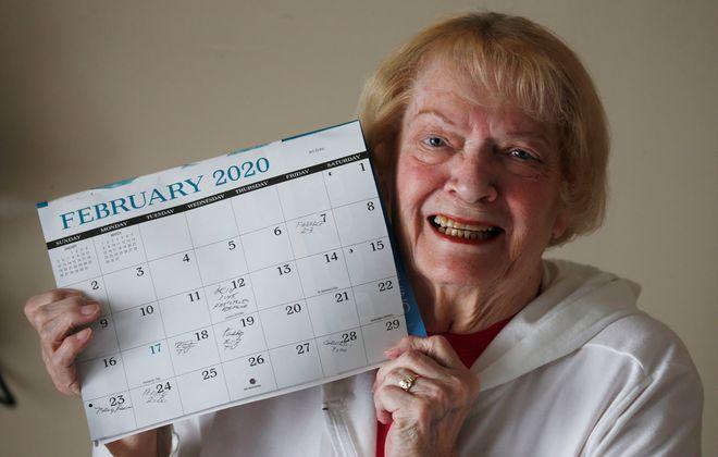 Johanna Ewing, a grandmother celebrating her 22nd birthday shows off the calendar like she did when she was 1. (Robert Kirkham/Buffalo News)