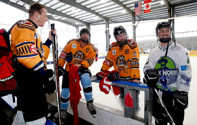 Lockport competitors from left, Aric Reeve, brothers Matt and Paul Stadlmier and Ken Norwich plan their line-up during the last day of the Labatt Blue Pond Hockey Tournament festivities at RiverWorks on Sunday, Feb. 16, 2020. (Robert Kirkham/Buffalo News)