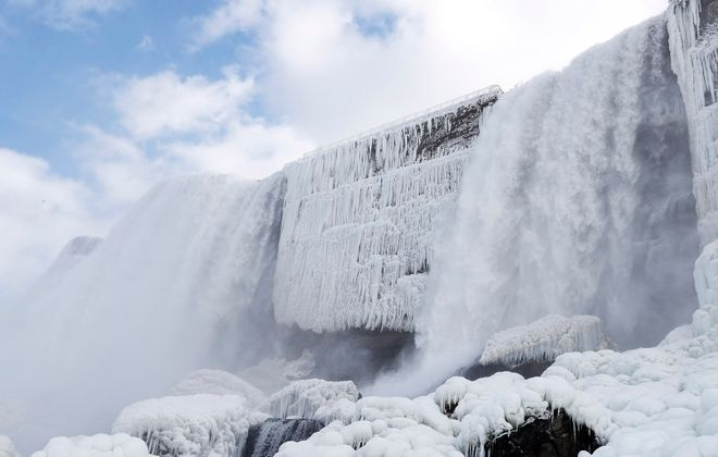 Tourists get a stunning winter view of the American and Bridal Veil Falls from below, Monday, Feb. 17, 2020. Because of the mild winter, Cave of the Winds at Niagara Falls State Park has been open in January and February. (Sharon Cantillon/Buffalo News)