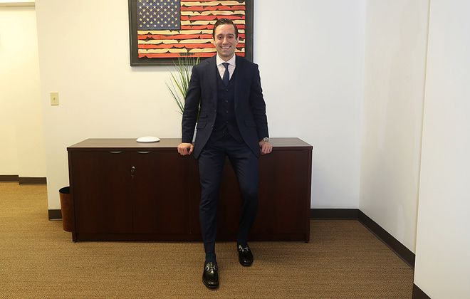 Attorney John E. Richmond, photographed in his Buffalo office, sports a three-piece suit. (John Hickey/Buffalo News)