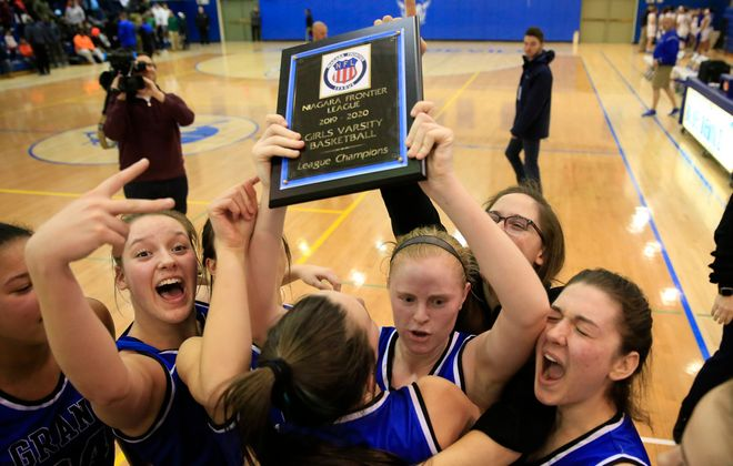 Grand Island players celebrate a victory over Lockport for the Niagara Frontier league championships at Kenmore West High School, on Wednesday, Feb. 19, 2020. (Harry Scull Jr./Buffalo News)