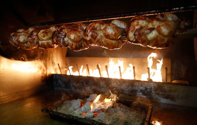 Almaza Grill is a Lebanese restaurant at 9370 Transit Road in East Amherst. The rotisserie chicken is cooked over flames and charcoal. (Sharon Cantillon/Buffalo News)