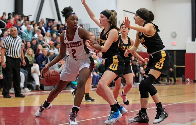 City Honors forward Kyra Wood is triple teamed by Holland during action at City Honors High School, on Friday, Feb. 21, 2020. (Harry Scull Jr./Buffalo News)